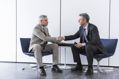 Business partners having a meeting, shaking hands - DIGF01549