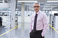 Portrait of a manager on shop floor of a factory - DIGF01651