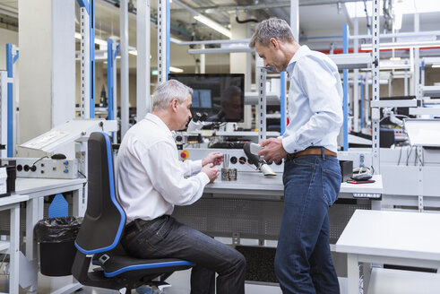 Two managers discussing product in company - DIGF01687
