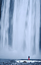Iceland, photographer at Skogafoss waterfall - RAEF01772