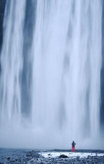 Iceland, photographer at Skogafoss waterfall - RAEF01772