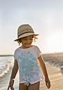 Spain, Menorca, smiling little girl on the beach - MGOF03172