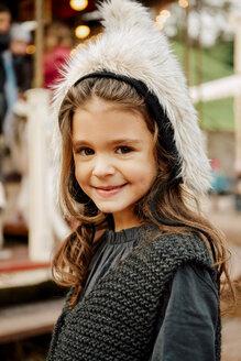 Portrait of smiling little girl wearing fur hat - CHAF01814