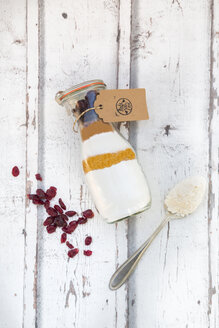 Glass bottle with ingredients of baking mix for cranberry chocolate cake - LVF05977