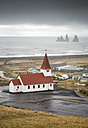 Iceland, Vik, church and stone trolls in the background - RAEF01781