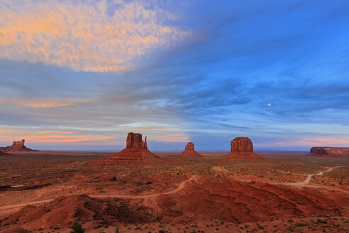 USA, Colorado Plateau, Utah, Arizona, Navajo Nation Reservation, Monument Valley, Sentinel Mesa, West Mitten Butte, East Mitten Butte and Merrick Butte at dawn with full moon - FOF09151