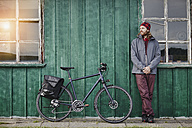 Young man on a bicycle tour having a break - RORF00754