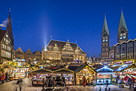Germany, Bremen, Christmas market on market square in the evening - PVC01064