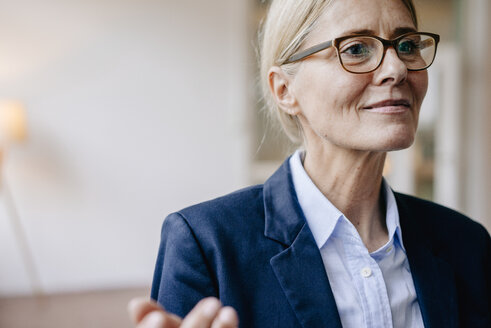 Portrait of confident businesswoman wearing glasses - JOSF00717