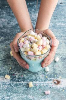 Girl's hands holding glass of unicorn milk - SARF03275