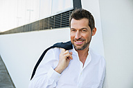 Portrait of confident relaxed businessman outdoors - CHAF01858
