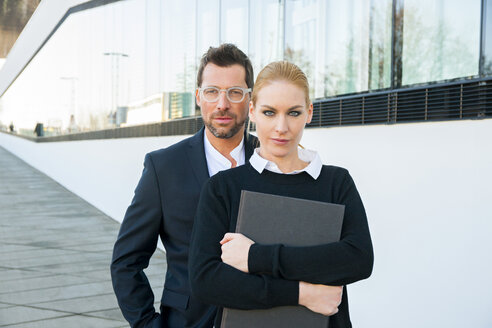 Portrait of confident businessman and woman outdoors - CHAF01864