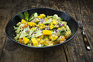 Bowl of quinoa salad with mango, avocado, tomatoes, cucumber, herbs and black sesame - LVF05986