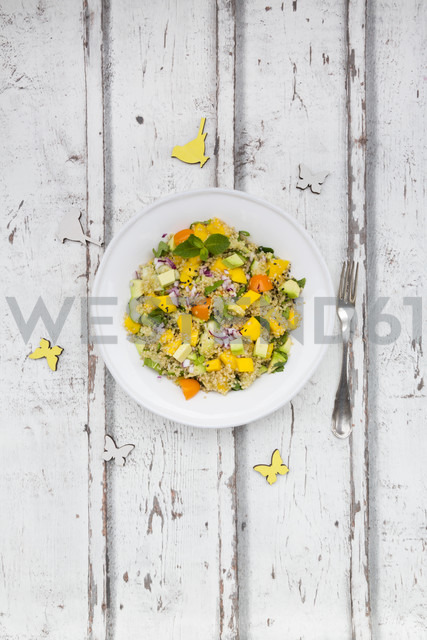 Plate of quinoa salad with mango, avocado, tomatoes, cucumber, herbs and black sesame - LVF05989