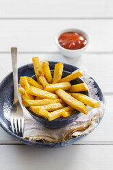 Bowl of swede fries and bowl of ketchup - EVGF03193