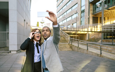 Young businessman and woman taking smart phone pictures - DAPF00635