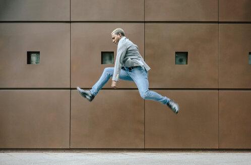 Businessman jumping for joy - DAPF00668