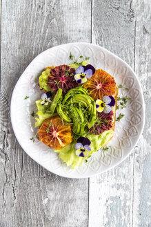 Toast garnished with iceberg salad, avocado, sliced blood orange, cress and horned violets - SARF03281