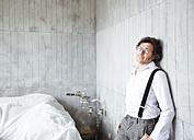 Portrait of content architect at construction site - REAF00254