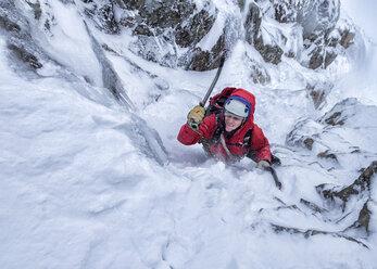 Scotland, Anoach Mor, Man ice climbing in winter - ALRF00894