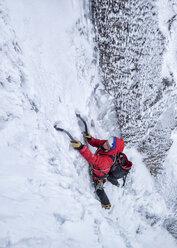 Scotland, Anoach Mor, Man ice climbing in winter - ALRF00897