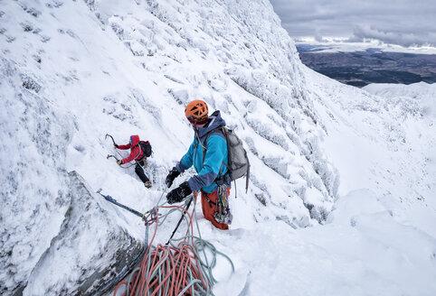 Scotland, Anoach Mor, Man ice climbing in winter - ALRF00900