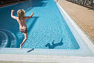 Boy jumping into swimming pool - SIPF01619