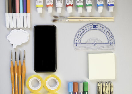 Top view of smartphone, protractor and artist's supplies - MOMF00033