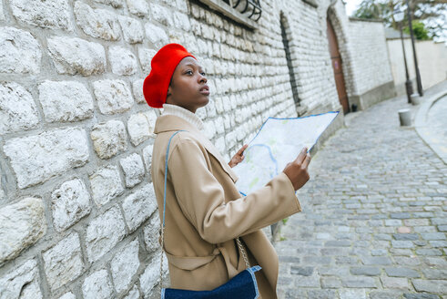 Young woman in Paris with city map - KIJF01356