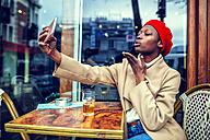 Young woman in Paris taking a selfie - KIJF01368