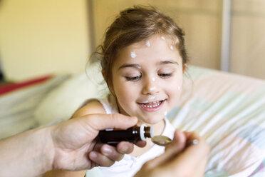 Girl having chickenpox receiving medicine - HAPF01427