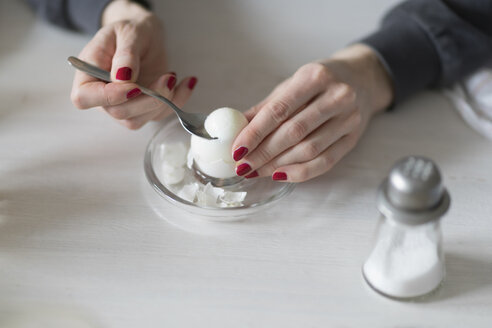 Close-up of woman eating boiled egg - CHPF00383