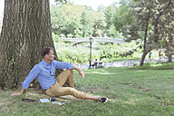 Man relaxing on a meadow in a park - BOYF00774