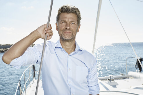 Portrait of mature man with stubble on sailing boat - PDF01128