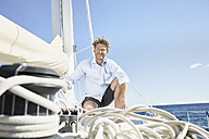 Portrait of smiling mature man on his sailing boat - PDF01137