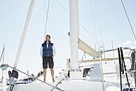 Mature man on his sailing boat - PDF01143