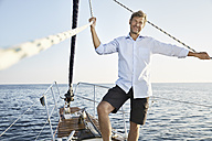 Portrait of smiling mature man on his sailing boat - PDF01152