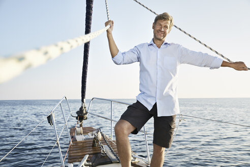 Portrait of smiling mature man on his sailing boat - PDF01152