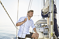 Mature man on his sailing boat - PDF01161