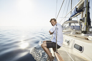 Portrait of smiling mature man on his sailing boat - PDF01167