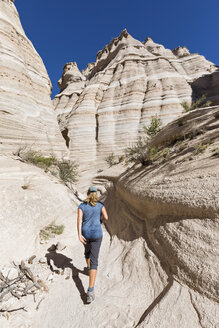 USA, New Mexico, Pajarito Plateau, Sandoval County, Kasha-Katuwe Tent Rocks National Monument, tourist in desert valley with bizarre rock formations - FOF09186