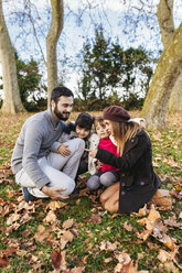 Happy family in autumnal park - MGOF03182