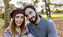 Portrait of happy couple in autumnal park - MGOF03197