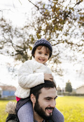 Portrait of happy little girl on shoulders of her father - MGOF03206