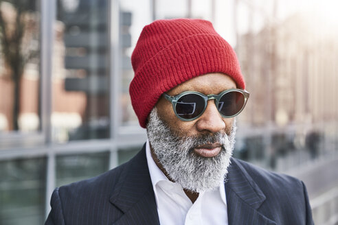 Mature businessman wearing red cap - FMKF03829