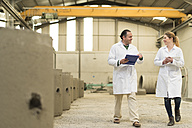 Chemists in concrete factory doing a quality check - JASF01587