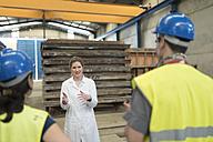 Scientist briefing workers in factory - JASF01605