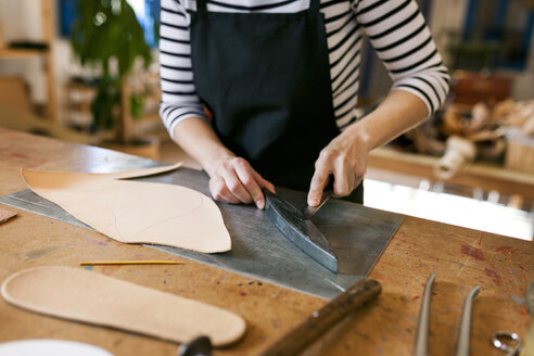 Close-up of shoemaker working on template in her workshop - VABF01303