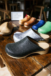 Assortment of clogs on table - VABF01324
