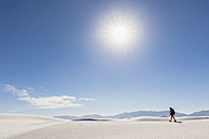 USA, New Mexico, Chihuahua Desert, White Sands National Monument, woman hiking on dune - FOF09213